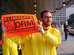 A man protests Digital Rights Management in Bo...