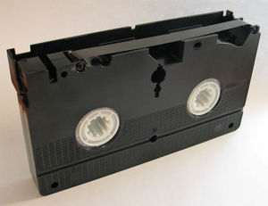Bottom view of VHS cassette with magnetic tape...