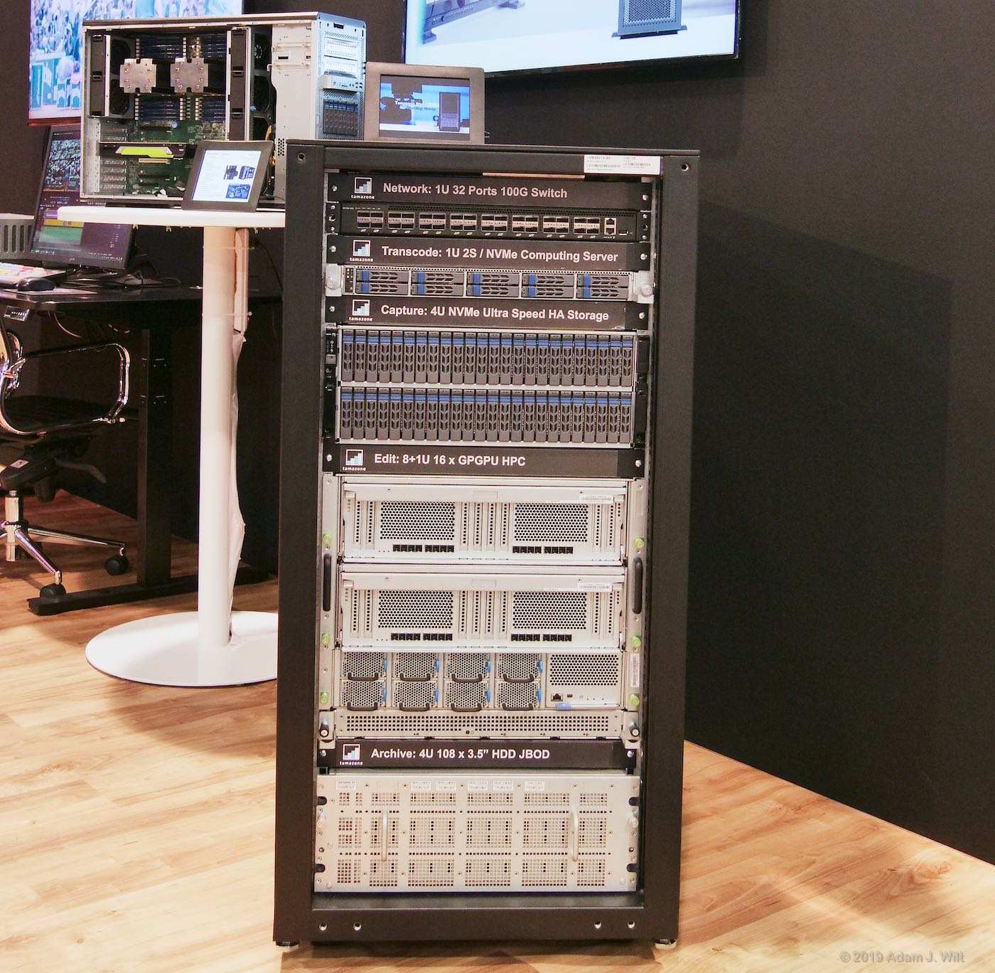 Rack of 8K gear at Sharp's booth. An editing PC is on the table behind it.