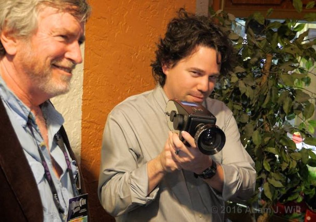 Carlos Acosta of Solid Camera wields a D16 while Jim Mathers of the Digital Cinema Society looks on