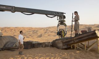 Star Wars: The Force Awakens..L to R: Director J.J. Abrams w/ actress Daisy Ridley (Rey) on set...Ph: David James..© 2015 Lucasfilm Ltd. & TM. All Right Reserved.