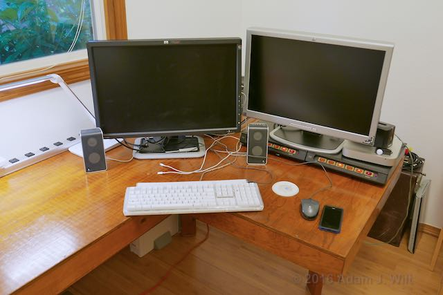 Two monitors on the desk