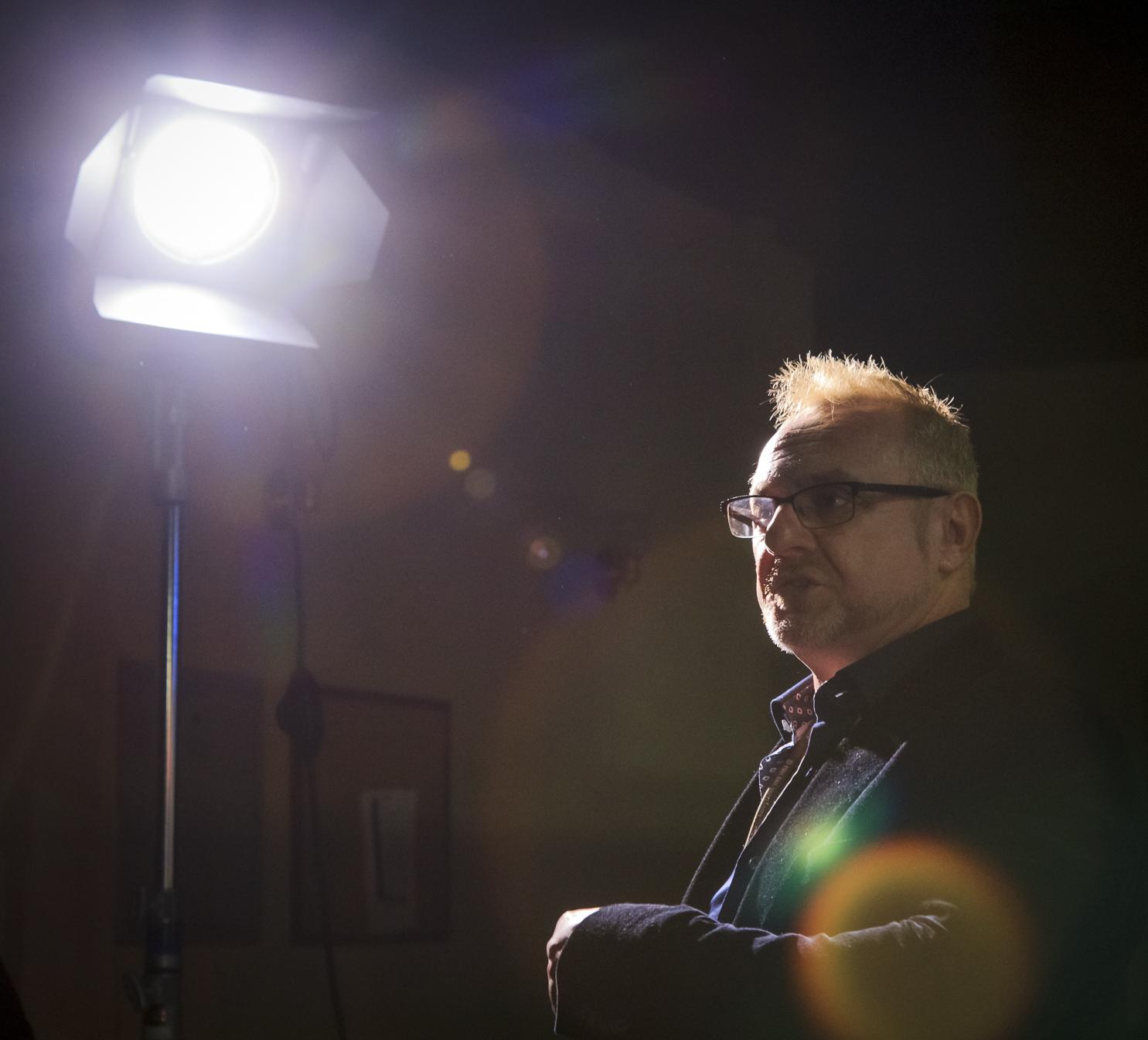 A Full Sail Professor talks cameras during a tour of a set