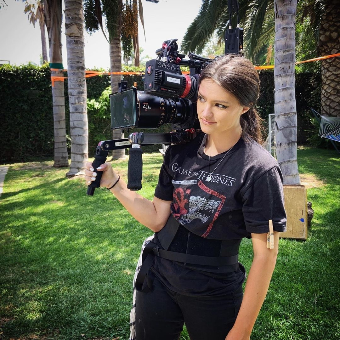 Kaity Williams holding her Arri AMIRA on set