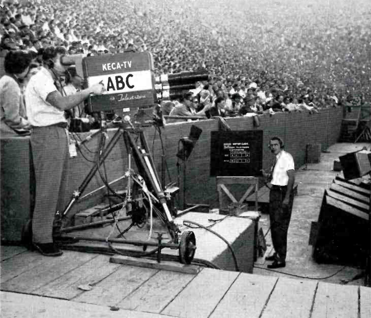 "A remote at the Los Angeles Coliseum. The camera is at field level to capture ""color"" of the game and also provide white on black titles to be superimposed on video from another camera high up in the press box. From RCA Broadcast News."