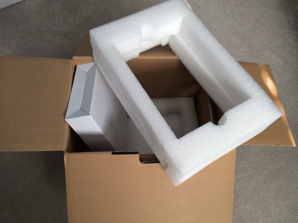 The box for many of these smaller desktop RAIDs are well padded and make an decent way to transport them.