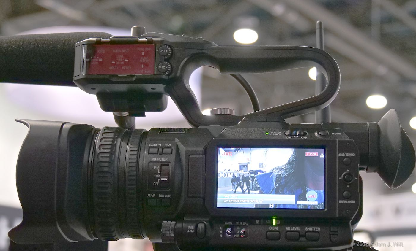 Handheld camcorder with wireless transmitter and built-in graphics