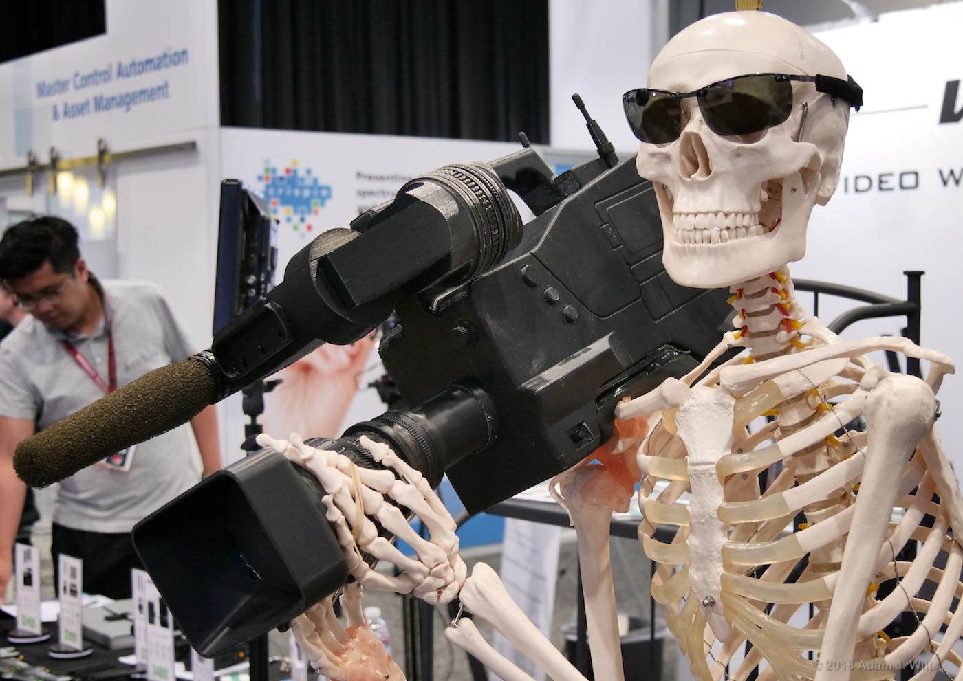 Skeleton holding an ENG camcorder
