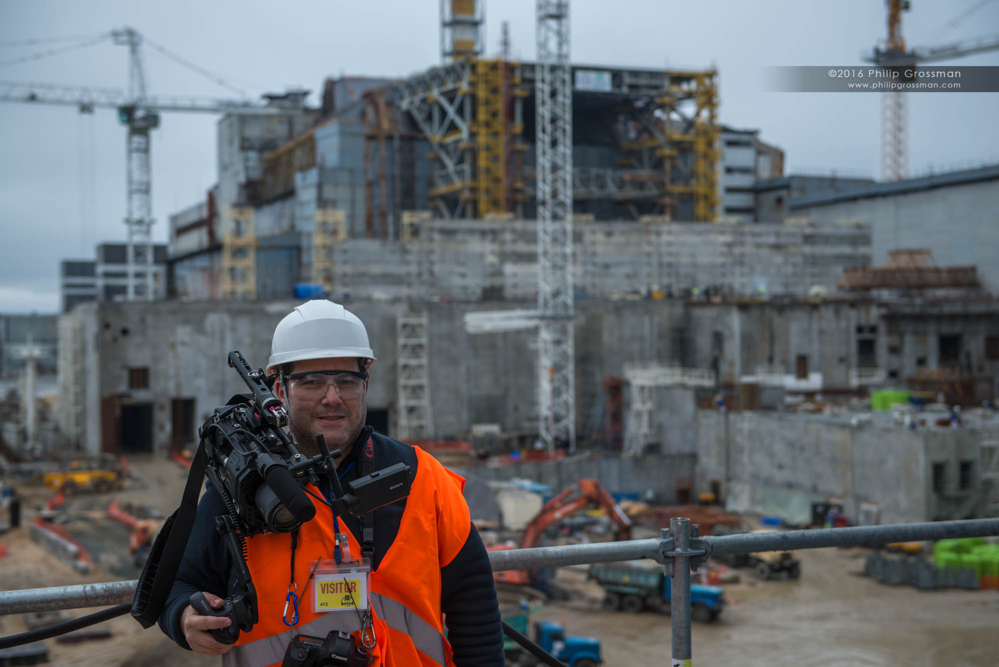 Philip standing about 6 stories up on scaffolding at the construction site of the New Safe Confinement Structure at the Chernobyl Nuclear Power Plant.