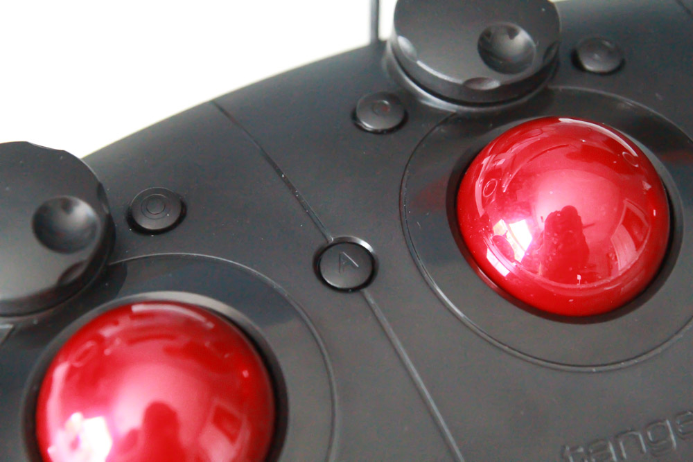 An A and B button between the trackerballs adds additional functionality.