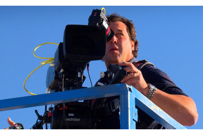 Cameraman Rudy Niedermeyer films a test flight. / CBS NEWS
