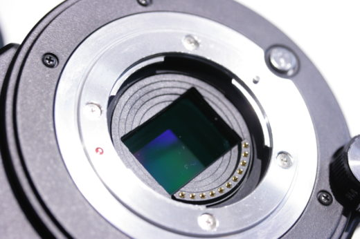 JVC GY-LS300 camera with lens removed, the blue infra-red filter and sensor beyond visible inside.