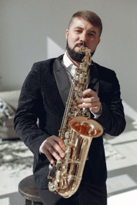 adult-man-playing-saxophone-on-concert-3984799