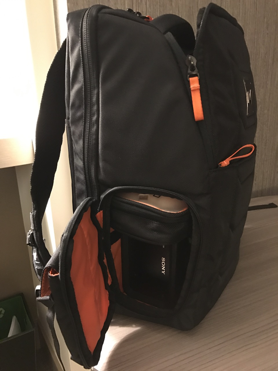 That's a Sony Rugged RAID peaking out of the bottom compartment. With a Macbook Pro in the bag it's an all-in-one editing go-bag.