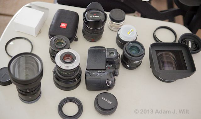 A mess o' lenses: adapters, diopters, primes, and zooms.