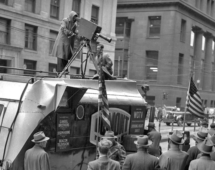 The WDTV Dumont remote truck parked on a downtown Pittsburgh, Pennsylvania, street and draws crown wanting to see themselves on television. Provided by the Texas Museum of Broadcasting & Communications www.txmbc.org