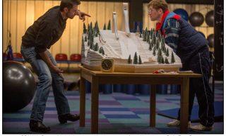 DF-02587 - Bronson (Hugh Jackman) puts things in perspective for aspiring ski jumper Eddie (Taron Egerton).