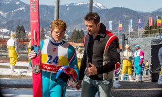 Eddie (Taron Egerton) and Bronson (Hugh Jackman) plan their next unorthodox training session.
