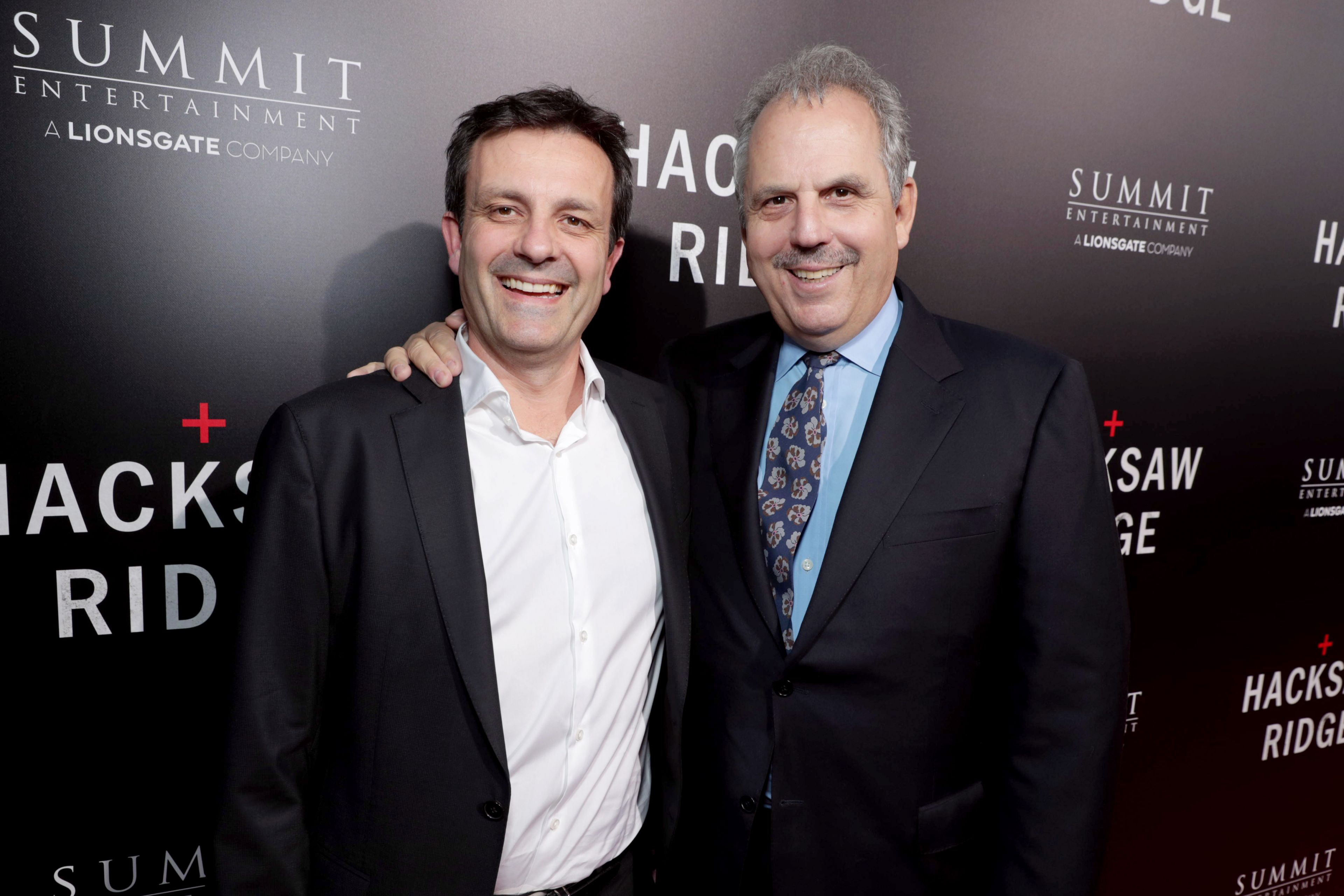"""Composer Rupert Gregson-Williams and Producer Bill Mechanic seen at Summit Entertainment, a Lionsgate Company, Los Angeles Special Screening of """"Hacksaw Ridge"""" at The Academy's Samuel Goldwyn Theater on Monday, Oct. 24, 2016, in Beverly Hills, Calif. (Photo by Eric Charbonneau/Invision for Lionsgate/AP Images)"""