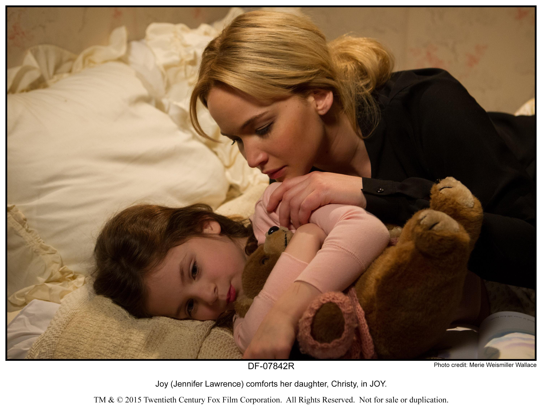 Joy (Jennifer Lawrence) comforts her daughter, Christy, in JOY.