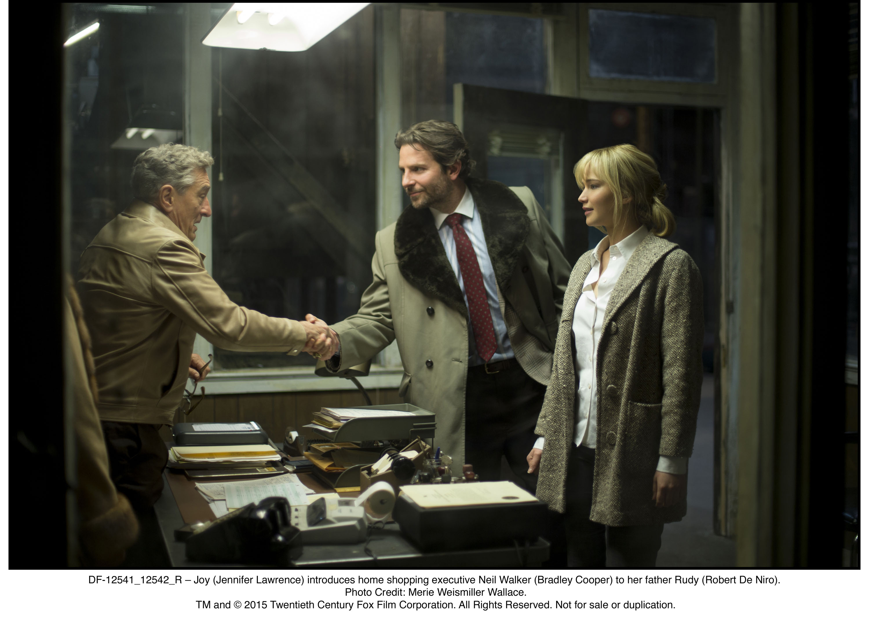 DF-12541_12542_R – Joy (Jennifer Lawrence) introduces home shopping executive Neil Walker (Bradley Cooper) to her father Rudy (Robert De Niro).