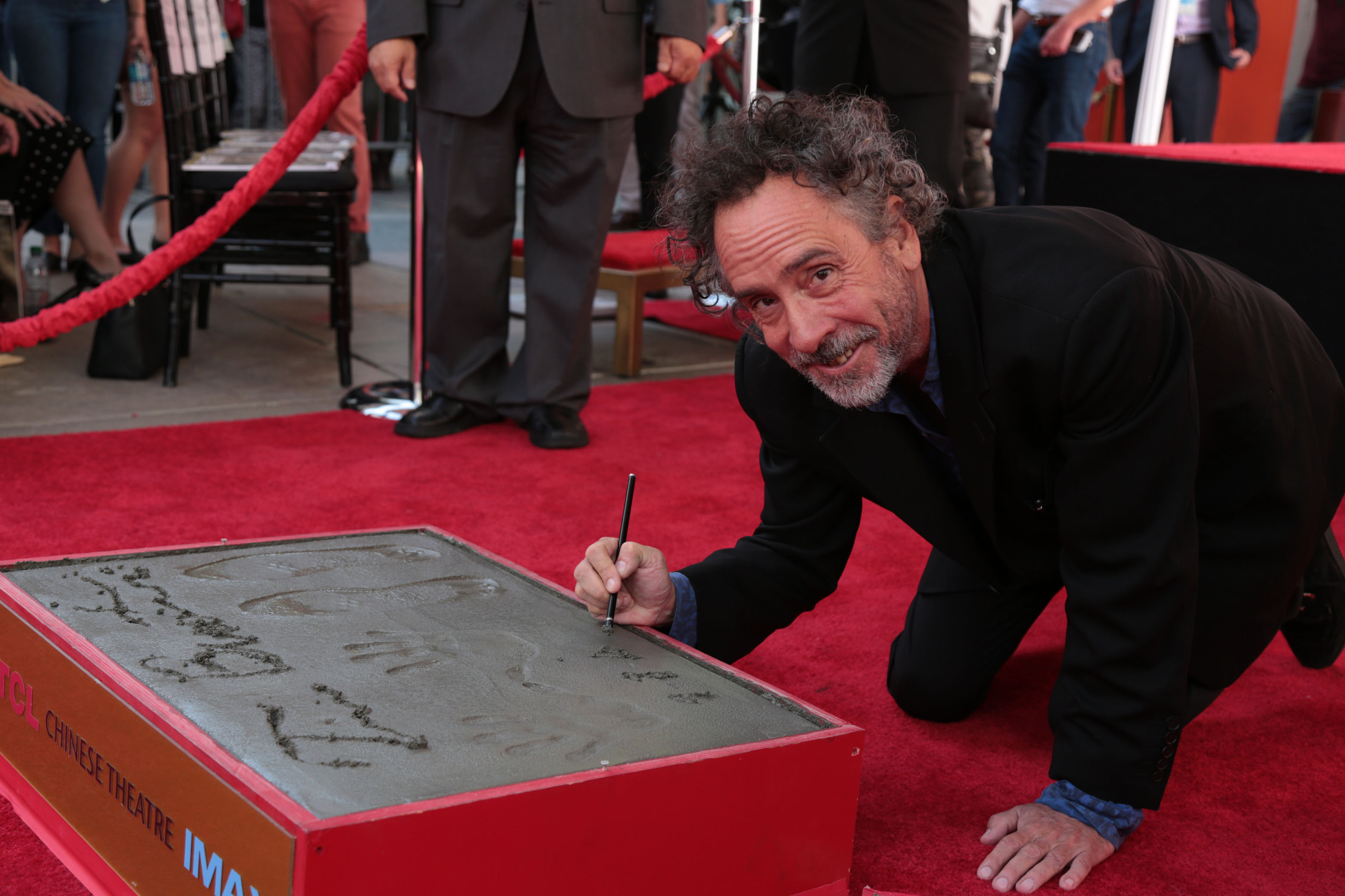 """Tim Burton celebrates at his Hand & Footprint Ceremony presented by 20th Century Fox in celebration of his newest film """"Miss Peregrine's Home for Peculiar Children"""" at the TCL Chinese Theatre in Los Angeles, CA on September 8, 2016. (Photo: Alex J. Berliner/ABImages)"""