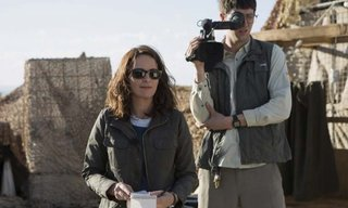 Left to right: Tina Fey plays Kim Baker and Nicholas Braun plays Tall Brian in Whiskey Tango Foxtrot.